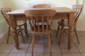 Kitchen table and four chairs made from sturdy pine
