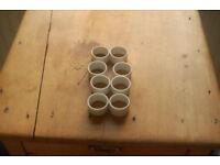 8 White ceramic napkin rings