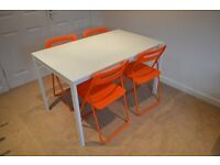 Ikea Melltorp dining table and four Nisse Orange folding chairs