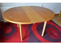 Solid wood extendable dining table.