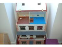 dolls house in good condition roof is on hinges middle section has door that opens