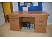 Wooden desk with filling draws