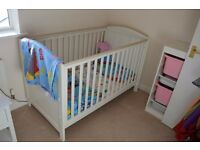 A white cot bed for sale.