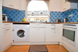 Beautiful newly refurbished two bed opposite Chalk Farm underground station .