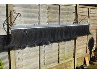 Rear brush type mud flap/dirt skirt for motor-home.