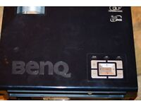 A Benq projector with an array of accessories