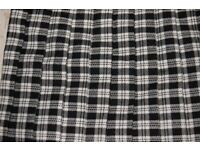 2 Dorothy Perkins skirts - black, grey and white chec and red, yellow orange check. Size 10