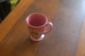 Vintage collectable Winnie the Pooh with wings, pink mug.