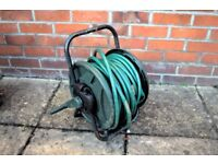 Hose reel and hose - £10