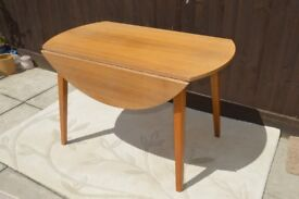 Round Dining Table with fold down sides