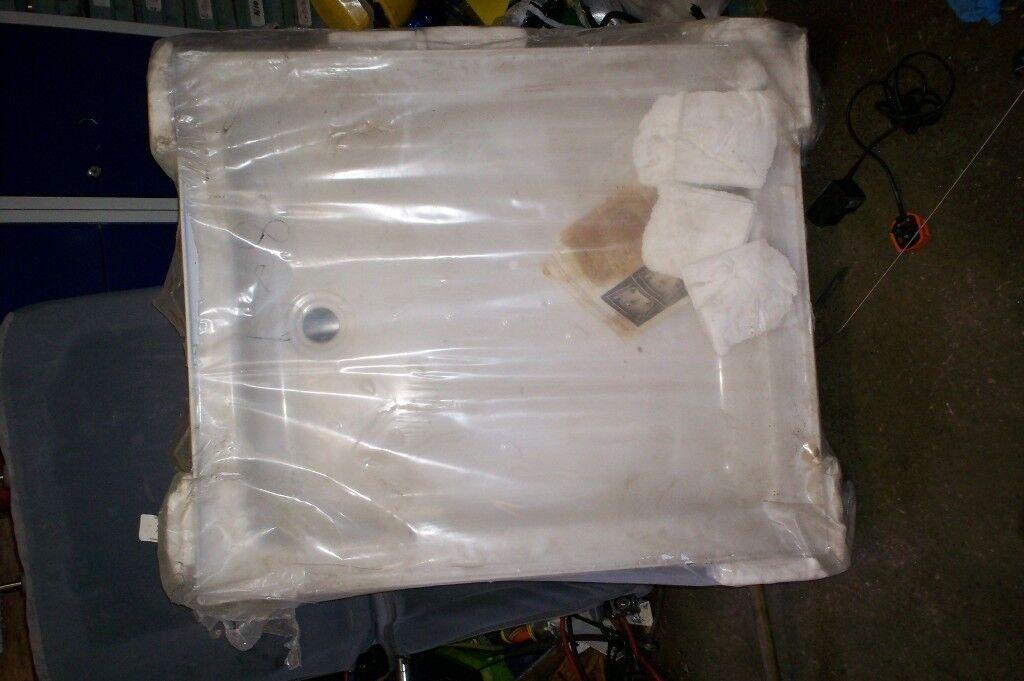 new unused shower trays