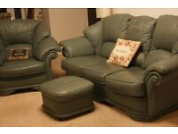 4 Piece Green Leather Suite - 3 seater settee, 2 armchairs and footstool/pouffe