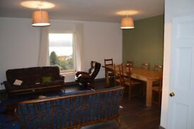 Spacious newly renovated 2 bedroom garden flat with private parking and amazing views out to Arran
