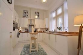 An impressive & extremely well presented 1st floor apartment within an converted historic building