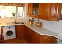 Kitchen with solid wood doors, drawers, worktop and sink