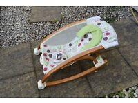 Fischer Price Baby Studio Wooden Rocker. Fabric cream with neutral coloured pattern.