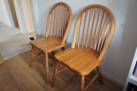 Two solid pine kitchen chairs - good condition - spindle back design - John Lewis