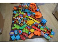 Large collection of Vtech Toot Toot track, buildings, road and vehicles.
