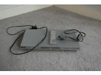 Silver DVD player with all cables and control