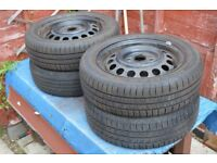 Four Car Tyres on Wheels