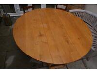 Solid oak drop leaf kitchen/dining table.