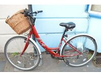 Ladies hybrid Apollo Cafe bike with a basket