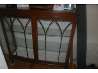 Vintage bow front dark wooden china cabinet with legs, glass shelves,