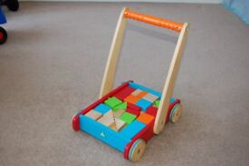 Early Learner Centre – push along wooden walker with bricks