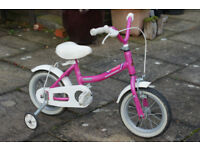 Child's Bike. Raleigh. First size with detachable stabilisers. Front brake only fitted