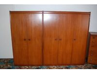 Two Wardrobes retro style consisting of a 2 door unit and a 3 door unit, by White and Newton