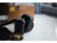 Nikon D7000 body plus extra(accept reasnable offers)