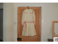 Vintage small cream knee lenght dress with pink sash and long sleeves