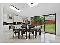 A stunning four-bedroom house located in a prime residential road ( Acton )