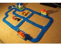Vintage Tomy Pull Back car and Track set, with 5 cars and 3 buildings