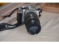 Canon 350d DSLR camera with Tamron 70 -300 telephoto lens.PLUS charger and battery .