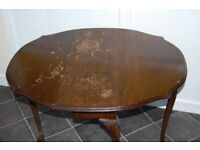 Antiques: A fine oval drop leaf table. Circa 1800. Very good working condition.