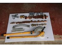 Copper hand pipe bender and assorted copper pipe fittings