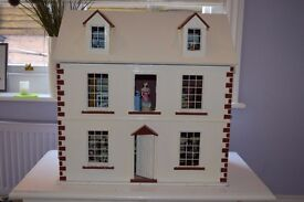 Traditional Dolls House with furniture and figures. Good condition, see photos for content.