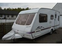 Swift Charisma 540 (2004) with full size awning.