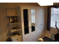 Schreiber Double Wardrobe with choice of doors, 3 draws and display shelving.