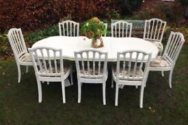 Beautiful large extending dining table and 8 dining chairs plus spare