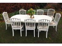 Beautiful large extending dining table and 8 dining chairs lid one spare