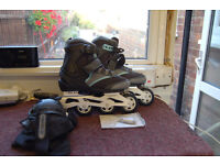 Oxelo Roller Blades As New, Size 5, Comes with Bag, Knee Cap Protectors.