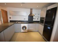This Stunning large two double bed 2 bath apartment with a large open plan kitchen reception