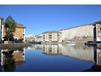 Grnd flr 2 bedroom holiday apartment with shower room, bathroom and allocated parking in the Marina