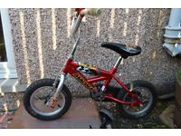Red Child's bike with stabilisers*