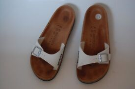 White Birkenstock Size 7.5 / 41. A LITTLE BIT MISSING ON ONE SANDAL