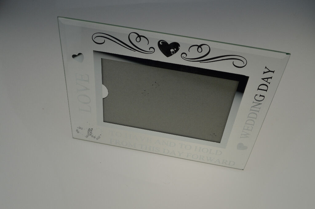 "6x4 Photo Frame with Mirror Glass Glitter Letters Lovein Handsworth, West MidlandsGumtree - (New) Glass Photo Frame with Glitter & Glass Letter Wording Frame will hold a picture sized 6"" x 4"" (15cm x 10cm) Frame Measures 22cm x 17cm The Frame has Glass letters reading ""Love"", ""Wedding Day"" and ""To have and to hold from this day..."