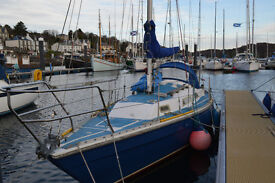 27 foot yacht berthed inTarbert Loch Fyne marina ready to sail.