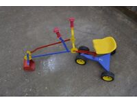A used metal ride on play digger
